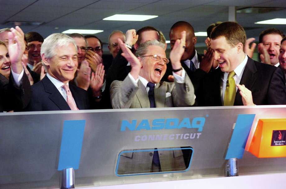 "Interactive Brokers CEO Thomas Peterffy, center, in May 2007 as he rings in the opening of the Nasdaq following the Greenwich firm's initial public offering of stock. On Sept. 12, 2018, Interactive Brokers announced plans to list its stock on the IEX, an exchange with a ""speed bump"" mechanism to prevent market abuses through the lightning trades of listed securities. Photo: ANDREW SULLIVAN / ST / 00002880A"