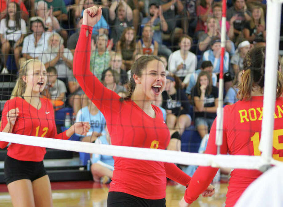 Roxana's Kiley Winfree celebrates a point earlier in the season with teammates Olivia Mouser (left) and Abbi Zangori (right) at Milazzo Gym. The Shells were back at home Tuesday and defeated rival EA-WR in two sets. Photo: Greg Shashack / The Telegraph