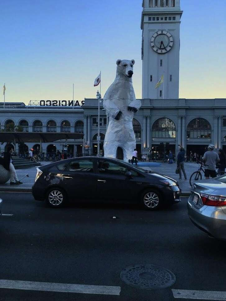 A 35-foot-tall polar bear sculpture made from car hoods looms tall in front of the San Francisco Ferry Building during the Global Climate Action Summit, September 2018.