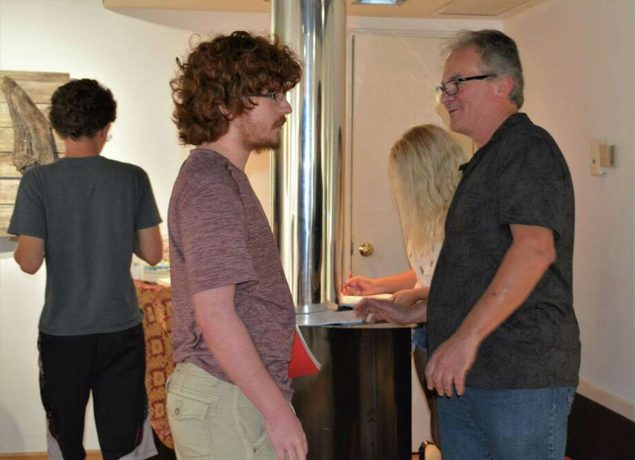 General studies student Kyle Versari with sculptor Peter Brown at the first opening reception of the school year at the WCCC gallery last week. Photo: Leslie Hutchison / Hearst Connecticut Media /