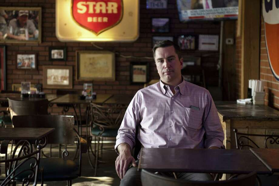 John Sellers, co-chief executive officer and co-founder of Double Eagle Energy III Holdings LLC, sits for a photograph at an oil-themed bar in Midland, Texas, U.S., on Tuesday, Aug. 21, 2018. Dozens of young entrepreneurs, mostly in their 30s, are running private-equity-backed companies in the frenzied boom in West Texas and New Mexico that may each be worth billions of dollars. Photographer: Callaghan O'Hare/Bloomberg Photo: Callaghan O'Hare, Bloomberg / © 2018 Bloomberg Finance LP