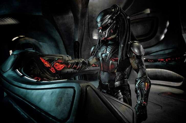 "The title alien in a scene from ""The Predator."""