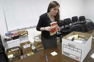 Public defender Amalia Beckner sorts out donated books, Friday, September 7, 2018, in Houston. She started crowdfunding books for her clients in the jail, after the Chronicle published a story about her efforts, and quickly, she recieved donations and eventually was able to do a book drive with the sheriff's office. Now, she's got a room full of donated books she's getting ready to give to the jail.