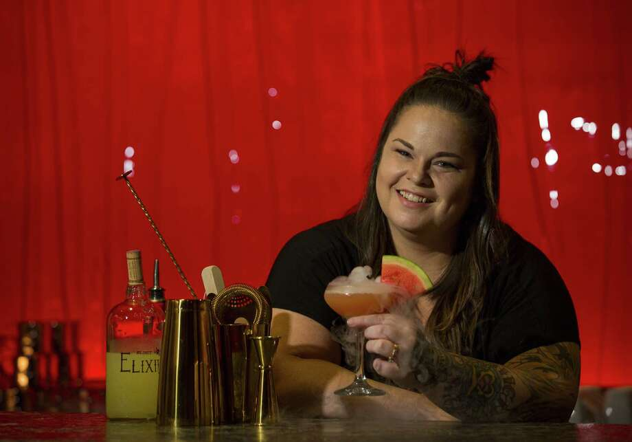 Alley Theatre bartender Lauren Muse with a cocktail she concocted for a themed party at theatre she has nicknamed the Buzz Aldrin. Photo: Mark Mulligan, Houston Chronicle / Staff Photographer / © 2018 Mark Mulligan / Houston Chronicle
