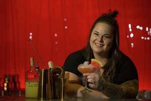 Alley Theatre bartender Lauren Muse with a cocktail she concocted for a themed party at theatre she has nicknamed the Buzz Aldrin.