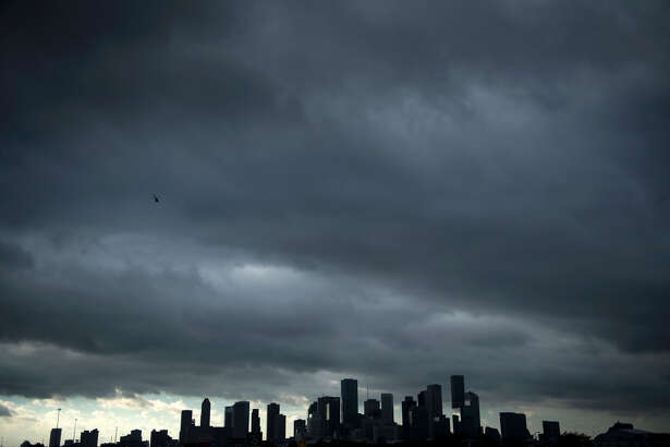 TOPSHOT - A view of the Houston skyline after heavy rains broke during the aftermath of Hurricane Harvey August 29, 2017. Harvey has set what forecasters believe is a new rainfall record for the continental US, officials said Tuesday. Harvey, swirling for the past few days off Texas and Louisiana has dumped more than 49 inches (124.5 centimeters) of rain on the region. / AFP PHOTO / Brendan Smialowski (Photo credit should read BRENDAN SMIALOWSKI/AFP/Getty Images)