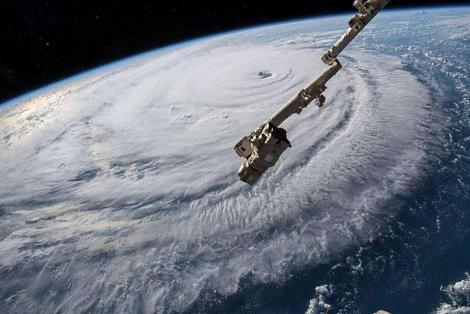 "A high definition camera outside the International Space Station captured a NASA view of Hurricane Florence on September 12, 2018, shown in this video still  taken as Florence churned across the Atlantic in a west-northwesterly direction with winds of 130 miles an hour. - Powerful Hurricane Florence headed toward the US East Coast Tuesday, prompting authorities to order more than a million people to evacuate the path of the extremely dangerous storm forecasters said could soon intensify. Residents scrambled to flee as the menacing Category 4 storm packing winds of 140 miles (220 kilometers) per hour moved closer.""This is one of the worst storms to hit the East Coast in many years,"" President Donald Trump warned on Twitter. ""Please be prepared, be careful and be SAFE!"" (Photo by HO / NASA / AFP) / RESTRICTED TO EDITORIAL USE - MANDATORY CREDIT ""AFP PHOTO / NASA"" - NO MARKETING NO ADVERTISING CAMPAIGNS - DISTRIBUTED AS A SERVICE TO CLIENTSHO/AFP/Getty Images Photo: HO, AFP/Getty Images"