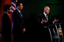 Gov. Jerry Brown speaks at Google headquarters in Mountain View, Calif., Tuesday, September 25, 2012, before signing a new bill regulating the ability of still-experimental driverless vehicles to operate on California roads.  Listening are Google co-founder Sergey Brin, left, and Senator Alex Padilla, center.