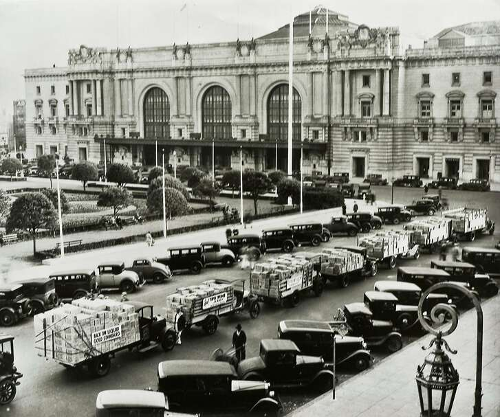 """In this December, 1933 photo, Italian Swiss Colony wines returned to retail store shelves and restaurant wine lists in San Francisco as Prohibition ended.  This parade of trays loaded with Tipo Chianti paused in the Civic Center of the nation's wine capital promising """"free delivery"""" to thirsty San Franciscans."""