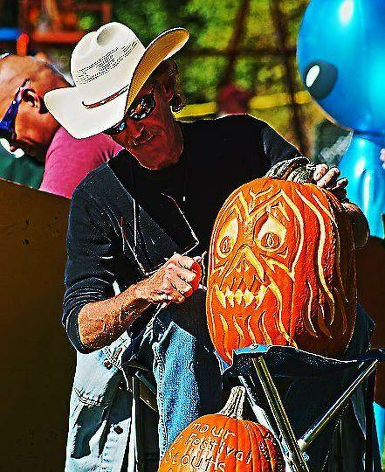 Seymour-- Craig Smith of Shelton carves a pumpkin at the 2012 Seymour Pumpkin Festival at French Memorial Park in Seymour. Photo: Peter Casolino / Hearst Connecticut Media File