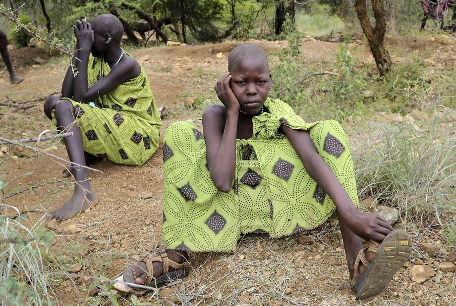 In this photo taken Monday, Aug. 6, 2018, two girl miners take a break at a gold mine outside the town of Kapoeta, South Sudan. South Sudan's five-year civil war has devastated the economy, fueling child labor in some of the country's most impoverished regions. (AP Photo/Sam Mednick) Photo: Sam Mednick / Associated Press