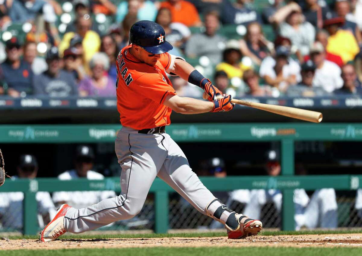 Houston Astros' Alex Bregman hits a one-run single in the third inning of a baseball game against the Detroit Tigers in Detroit, Wednesday, Sept. 12, 2018. (AP Photo/Paul Sancya)