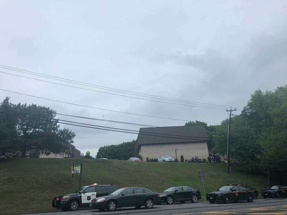 Two drones are hovering over the Fenimore Trace Apartments on Route 2 in Watervliet. Police are on the scene of a possible standoff. Photo: Sara Cline / Times Union