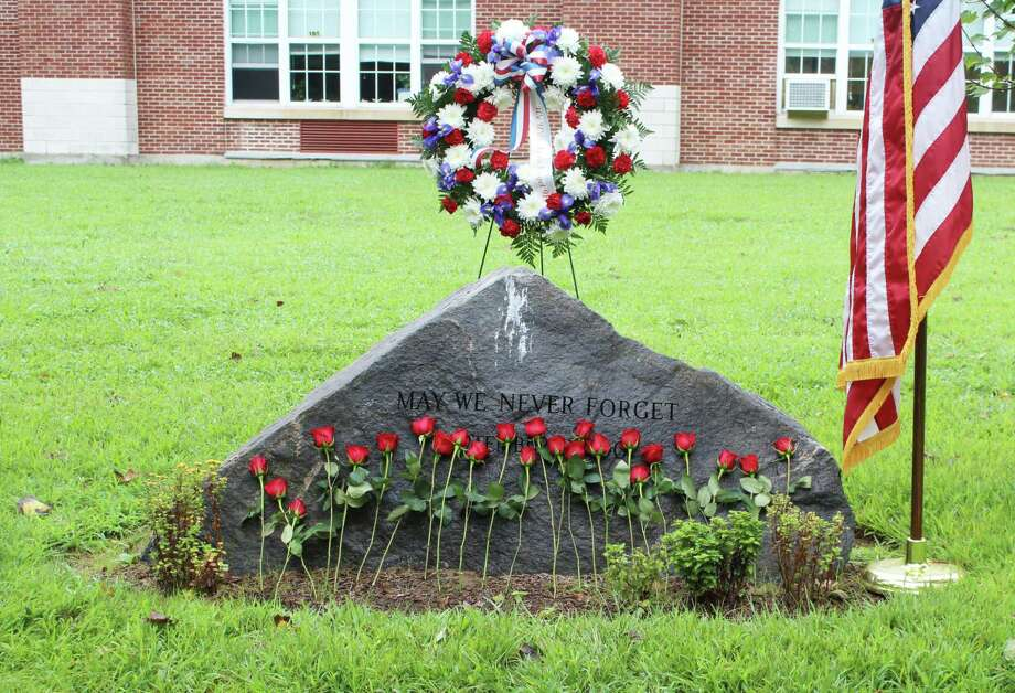 "Roses line the Sept. 11 memorial behind Middlesex Middle School. The stone reads ""May we never forget."" Taken Sept. 11, 2018. Photo: /Lynandro Simmons /Hearst Connecticut Media"
