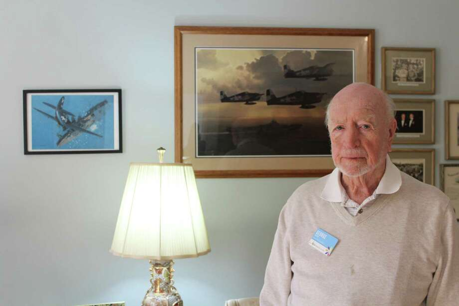 George Walsh standing in front of a portrait of divebombers. Taken Sept. 6. Photo: /Lynandro Simmons /Hearst Connecticut Media
