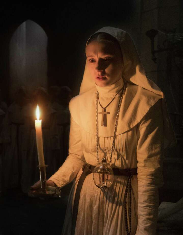 "This image released by Warner Bros. Pictures shows Taissa Farmiga in a scene from ""The Nun."" Photo: Justin Lubin / Associated Press / © 2017 Warner Bros. Entertainment Inc"