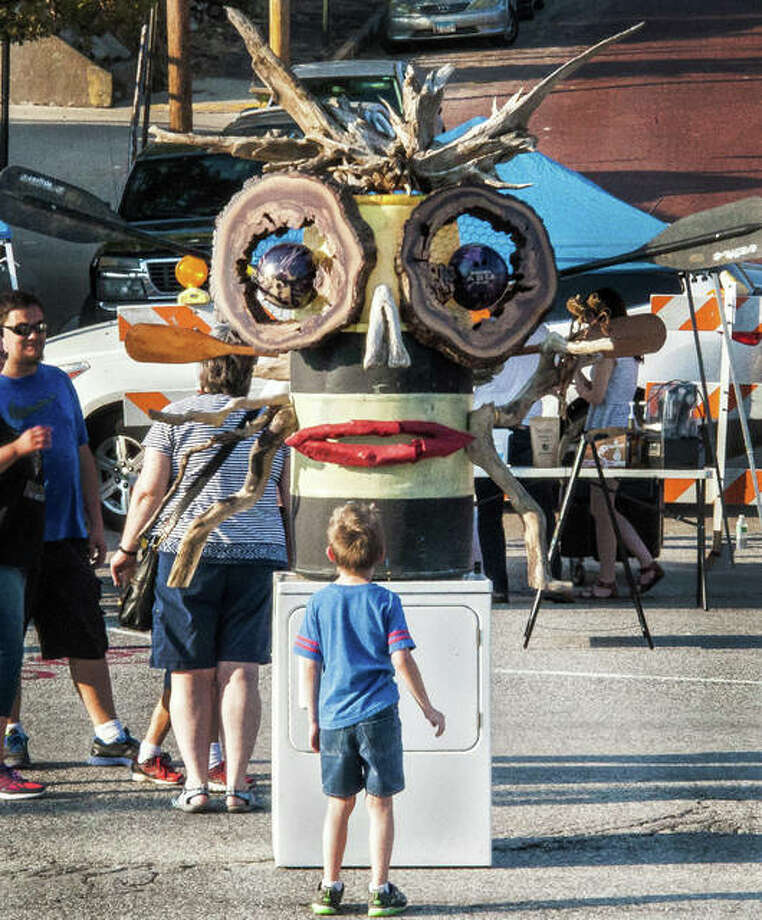 A boy examines a piece of art made by local artist Michael Snider during last year's Mississippi Earthtones Festival Photo: Nathan Woodside | Telegraph File Photo