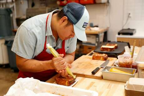 James Wong makes Kaya Toast during Breadbelly's pop-up stand at Andytown Roastery. Photo: Scott Strazzante / The Chronicle
