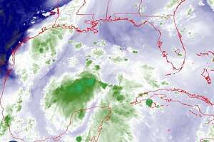 These images show Invest 95L as it appeared on Wednesday in satellite images. (9/12/18)
