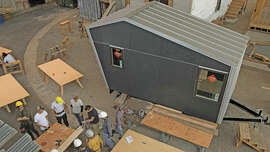Students at Laney College in Oakland participate in the school's tiny house-building course on Aug. 31, 2017.  (D. Ross Cameron)