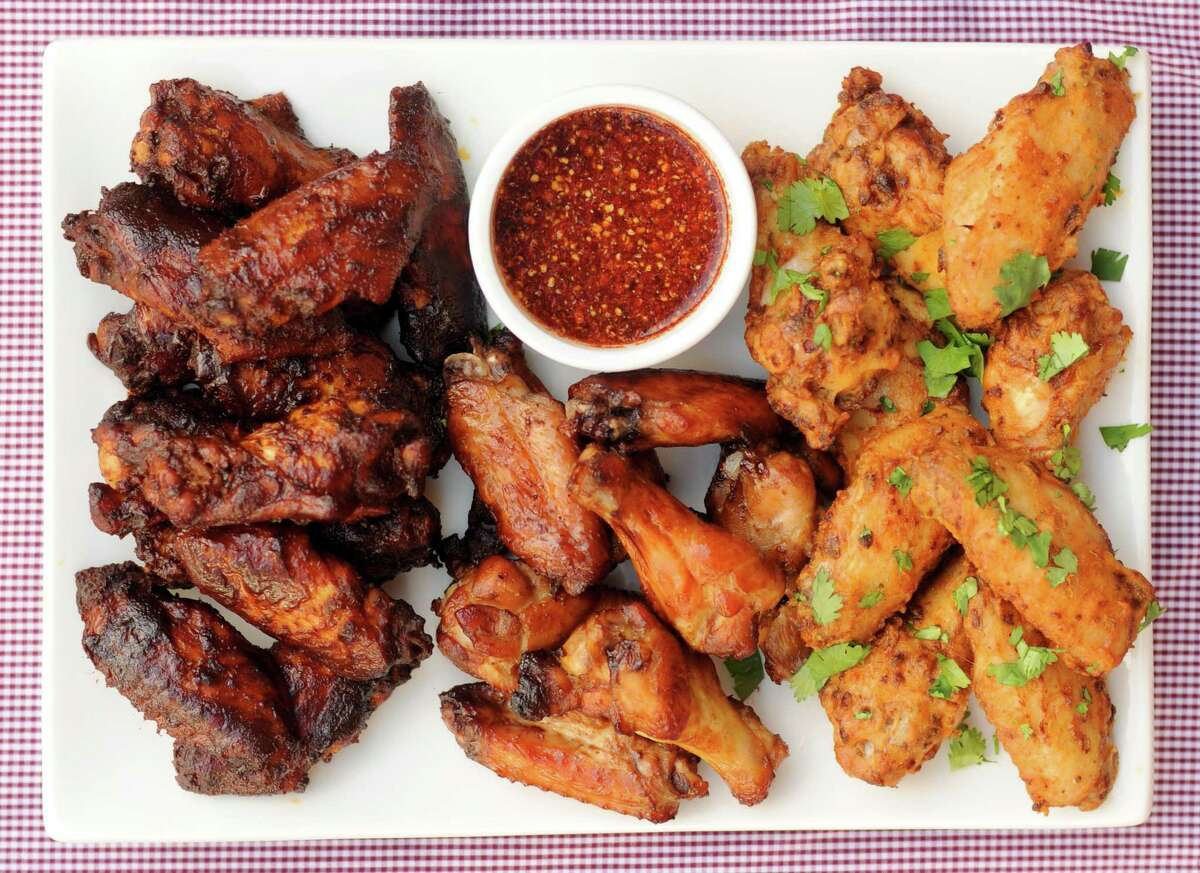 Oven-baked chicken wings including (from left) Wing Dings, Thai Wings with Jaew and Guava Habanero Wings.