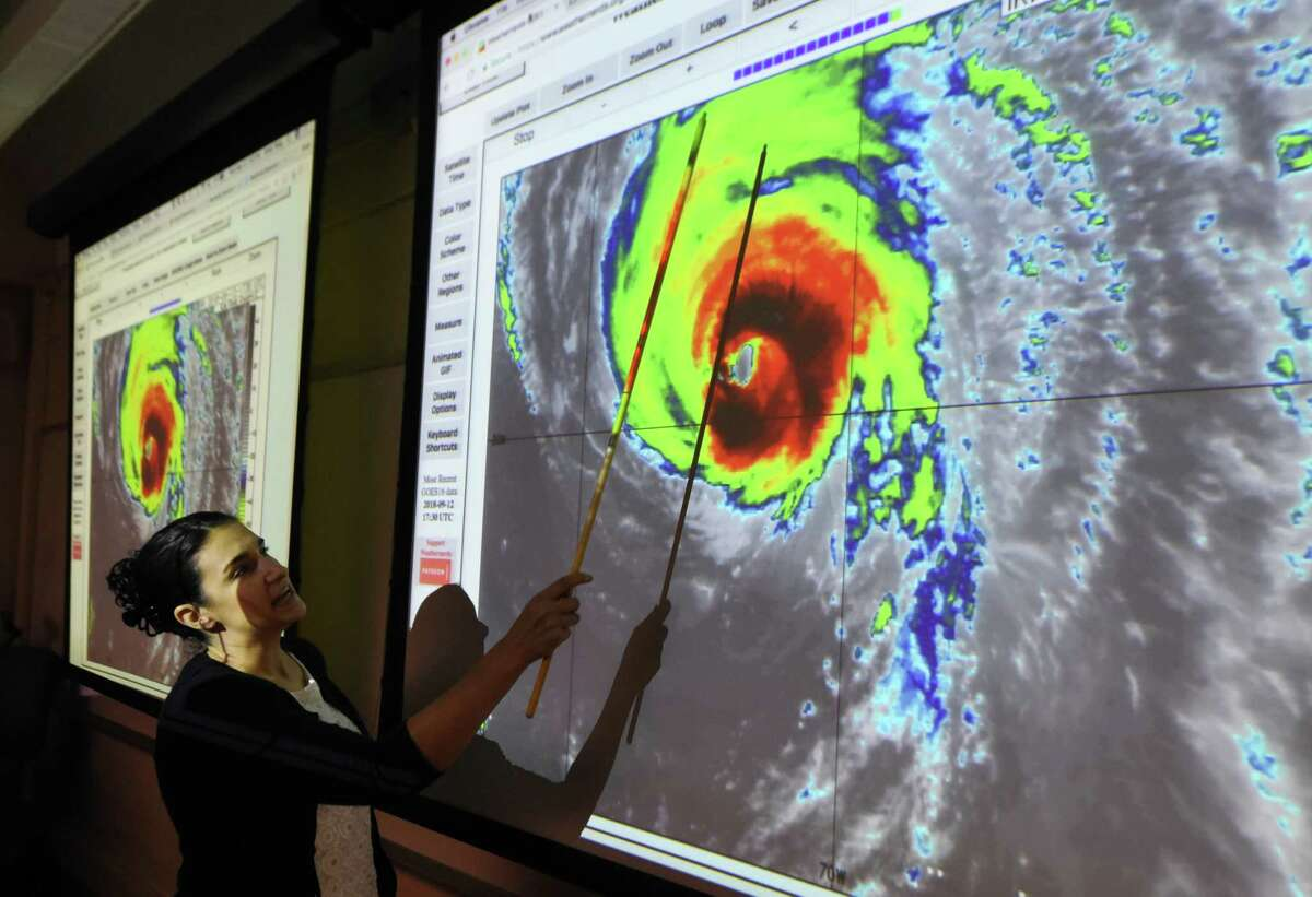 University at Albany professor of atmospheric science, Kristen Corbosiero points to features in a satellite infrared image of Hurricane Florence during a discussion and presentation at the school's Department of Atmospheric and Environmental Sciences on Wednesday, Sept. 12, 2018, in Albany, N.Y. (Will Waldron/Times Union)