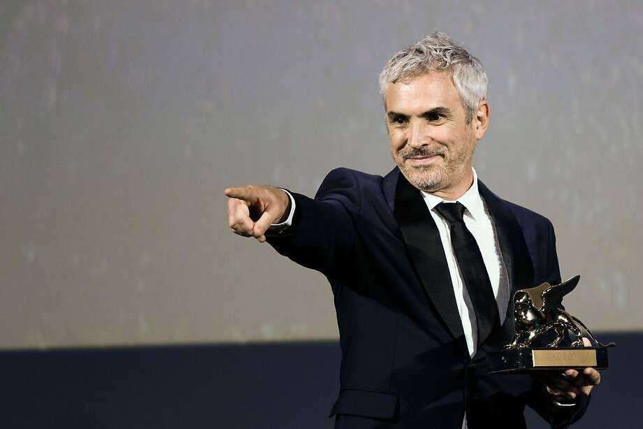 "Director Alfonso Cuaron reacts after receiving the Golden Lion award for Best Film for the movie ""Roma"" during the awards ceremony of the 75th Venice Film Festival on September 8, 2018 at Venice Lido. (Photo by Filippo MONTEFORTE / AFP)FILIPPO MONTEFORTE/AFP/Getty Images Photo: FILIPPO MONTEFORTE, AFP/Getty Images"