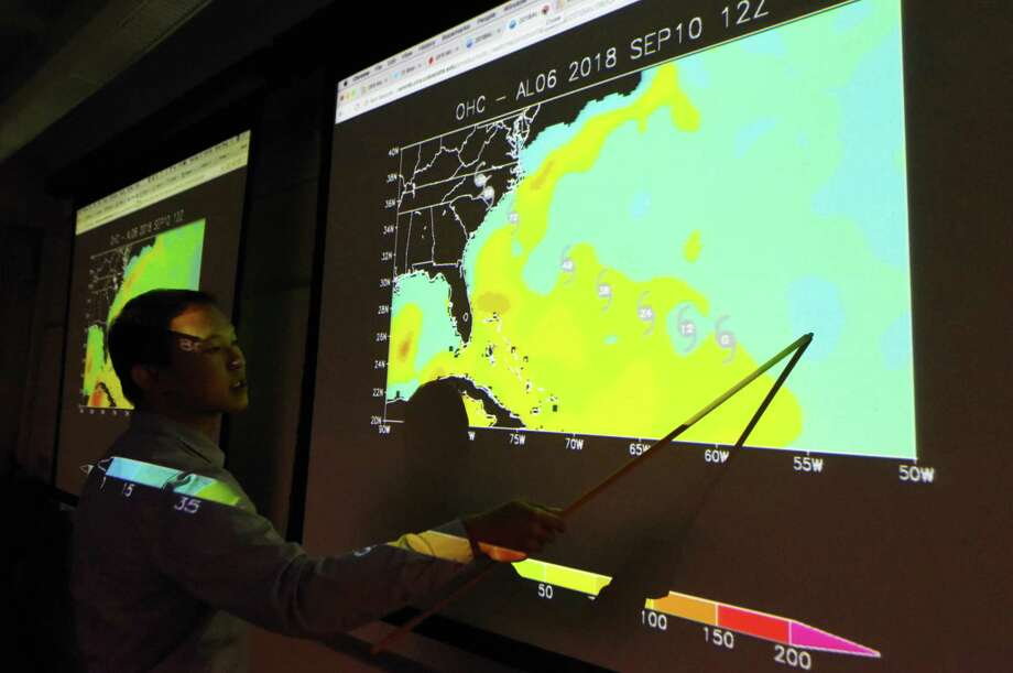University at Albany professor of atmospheric science,  Brian Tang displays a map showing oceans temperatures relative to Hurricane Florence during a discussion and presentation at the school's Department of Atmospheric and Environmental Sciences on Wednesday, Sept. 12, 2018, in Albany, N.Y. (Will Waldron/Times Union) Photo: Will Waldron, Albany Times Union / 20044818A