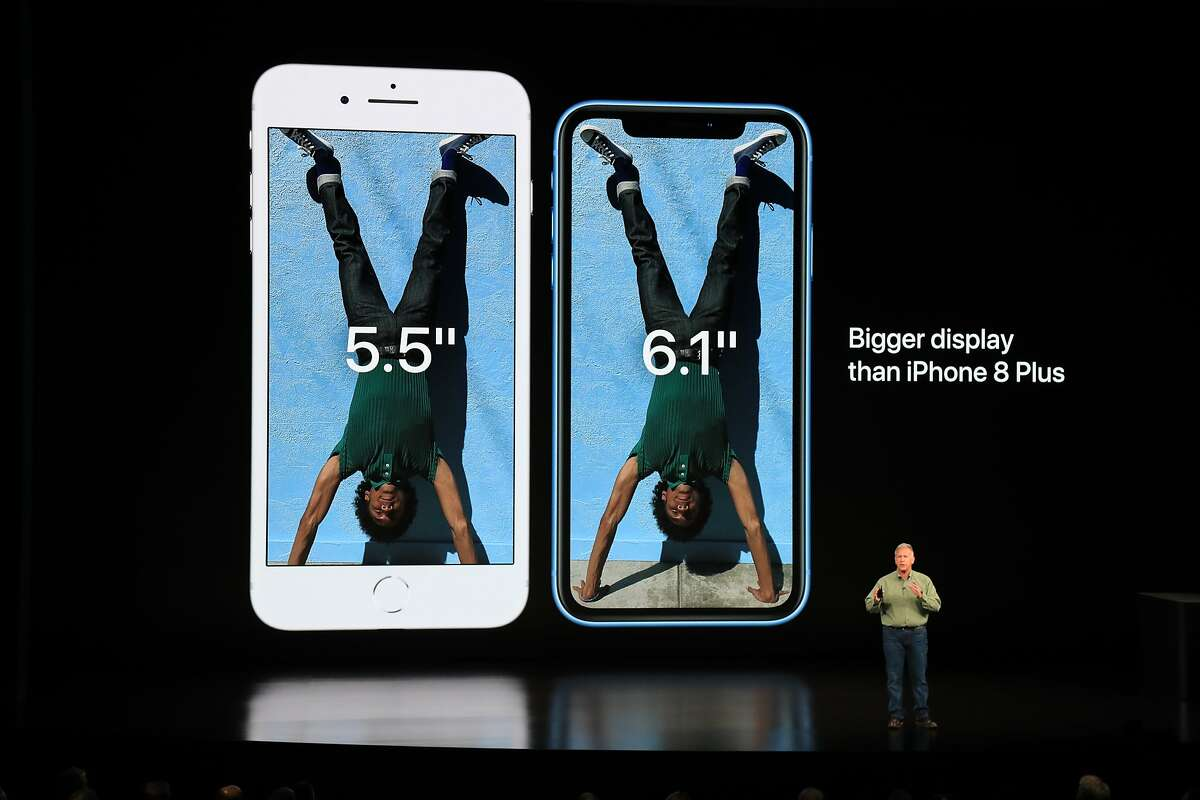 Philip Schiller, Apple�s senior vice president for marketing, shows off the new iPhone Xs and iPhoneXs Max at a new product launch event in Cupertino, Calif., Sept. 12, 2018. This is the second year that Apple is unveiling its new items at its own venue, the Steve Jobs Theater at its new spaceship headquarters in Cupertino. (Jim Wilson/The New York Times)
