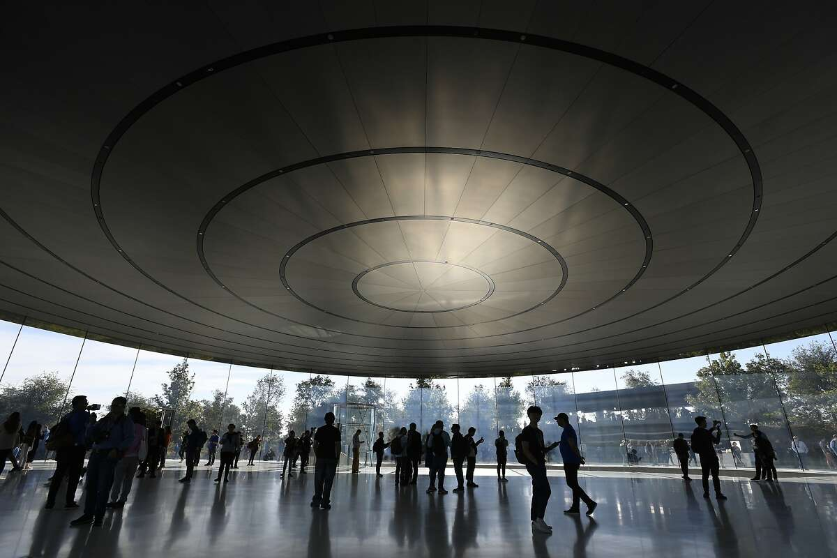 Attendees arrive for an Apple Inc. event at the Steve Jobs Theater in Cupertino, California, U.S., on Wednesday, Sept. 12, 2018. Apple will kick off a blitz of new products this week, ending a year of minor updates and setting the technology giant up for a potentially strong holiday quarter. Photographer: David Paul Morris/Bloomberg