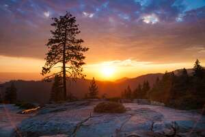 The sun goes down over Beetle Rock in Sequoia National Park on an August evening.