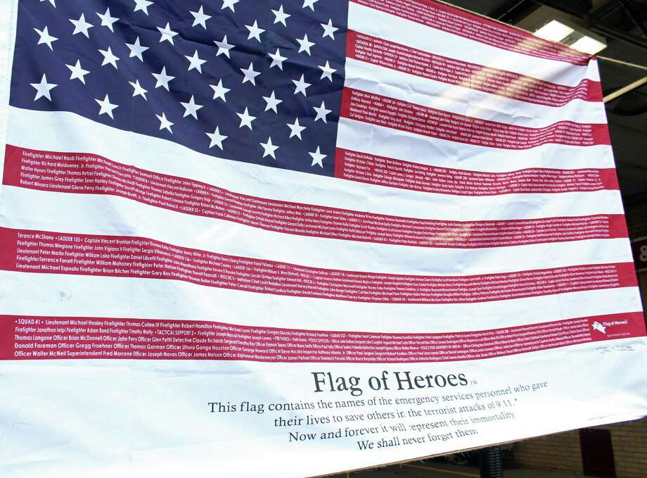 "A ""Flag of Heroes,"" listing the names of first responders killed in the Sept. 11 terrorist attacks, served as a backdrop for the town's annual 9-11 remembrance. Fairfield,CT. 9/11/18 Photo: Genevieve Reilly / Hearst Connecticut Media / Fairfield Citizen"