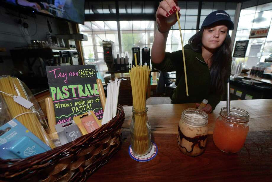 Harbor Harvest barista, Brittany Tarantino, serves up a Rise Nitro cold-brew coffee drink with their new pastraws, a pasta straw, and aLemon Ginger Ice Tea with the reusable Ultimate Straw Wednesday, September 12, 2018, at their location in Norwalk, Conn. Non-plastic straws have become all the rage in Norwalk, with many restaurants pledging to get rid of plastic. But many are having trouble procuring the paper straws because distributors are backlogged. The straws also cost more money and break down in liquid, causing certain restaurants to consider other options, like corn-based or reusable steel straws. Photo: Erik Trautmann / Hearst Connecticut Media / Norwalk Hour