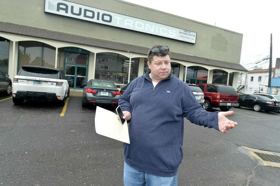 Michael Burton talks about the new fees imposed by the new owner for the the parking lot at his Isaacs St building at his store Audiotronics at 18 Isaacs Street on Tuesday September 11, 2018 in Norwalk Conn. Photo: Alex Von Kleydorff / Hearst Connecticut Media / Norwalk Hour