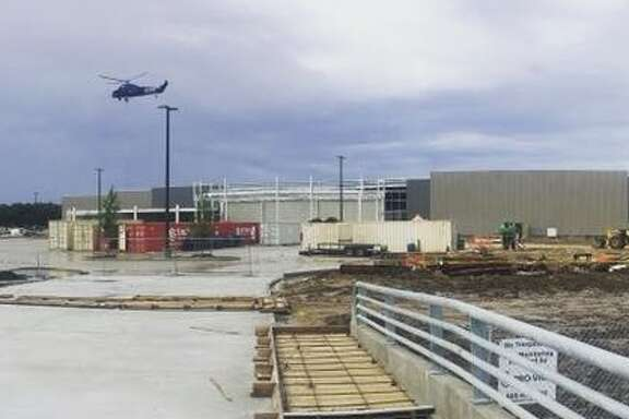 As construction at Webster's new Costco store continues, a helicopter was seen Wednesday morning placing new A/C units on top of the building.