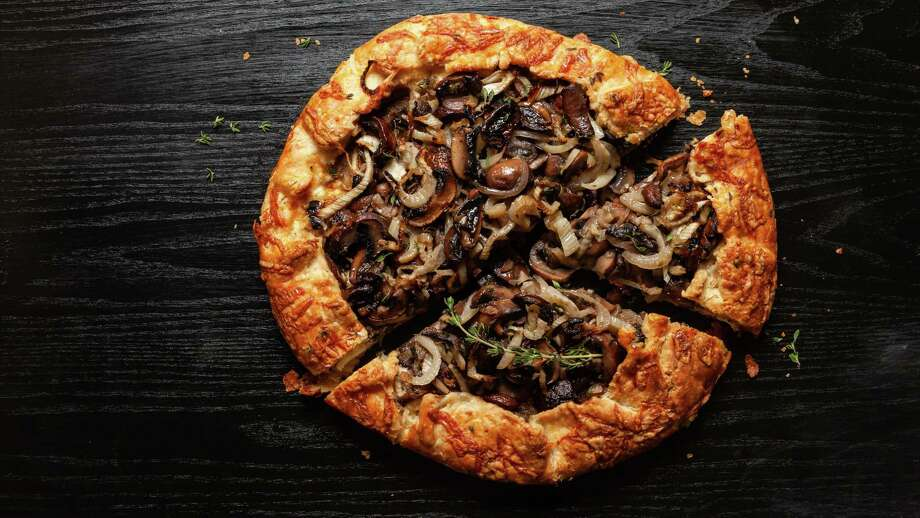 Mushroom, Fennel and Herbed Ricotta Galette. Photo: Photo For The Washington Post By Goran Kosanovic. Food Styling For The Washington Post By Lisa Cherkasky / Goran Kosanovic for The Washington Post