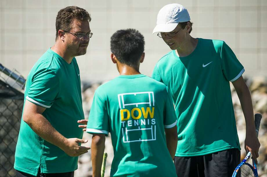 FILE — Dow High varsity tennis coach Terry Schwartzkopf, left, speaks to Dow No. 2 doubles pair senior David Lin, center, and senior Peter Redman, right, during their match against Forest Hills Central in the Midweek Classic Quad on Wednesday, Sept. 12, 2018 at Greater Midland Tennis Center. (Katy Kildee/kkildee@mdn.net) Photo: (Katy Kildee/kkildee@mdn.net)