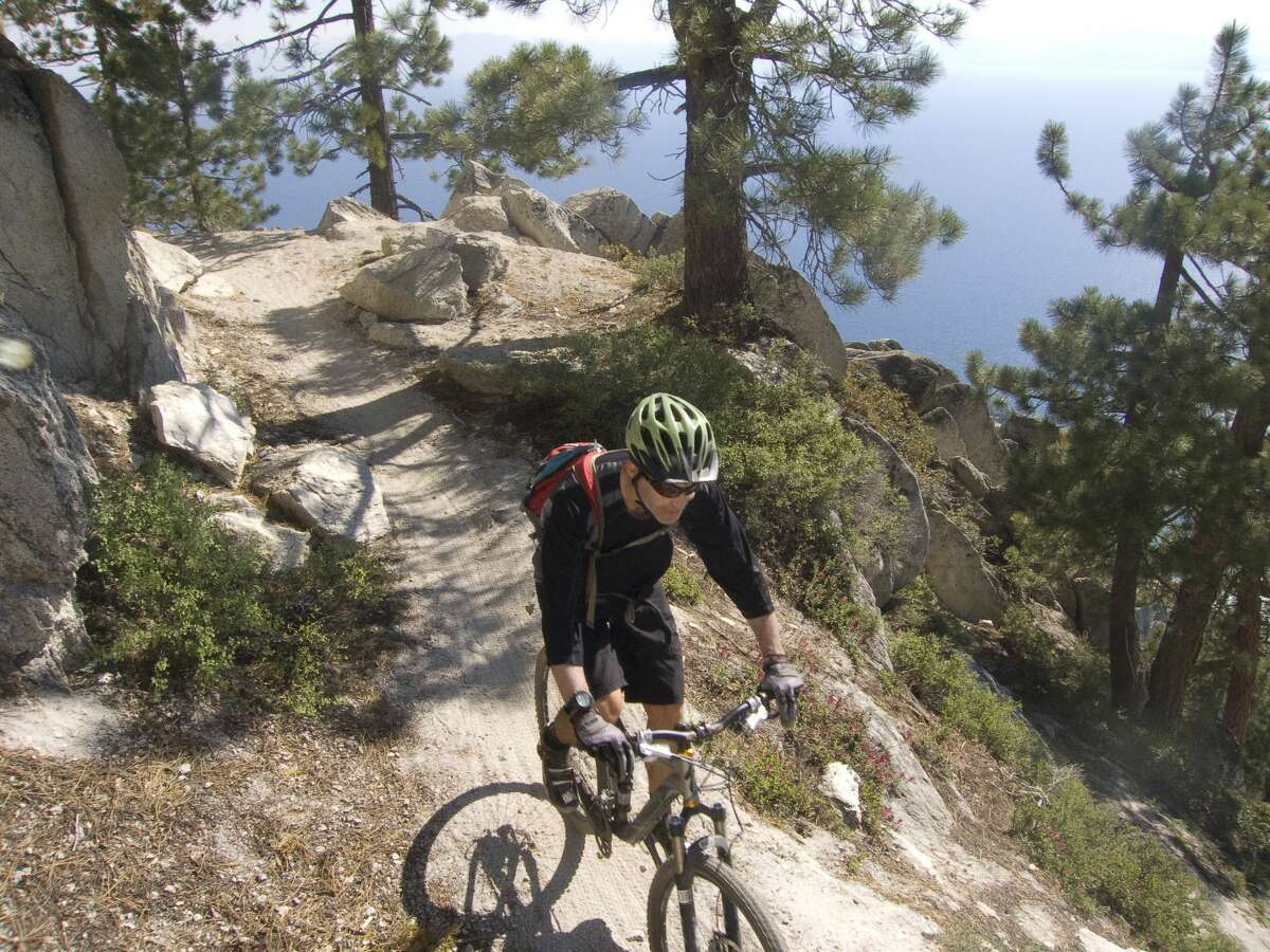 A man rides the Flume Trail in Lake Tahoe in this file photo. A human skull was found by the trail Sunday.