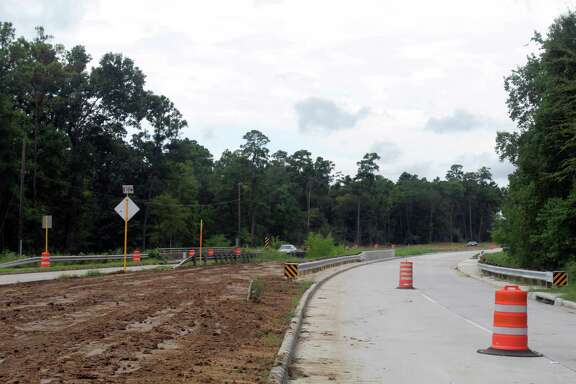 Vehicles coming from FM 1960 pass construction barrels on their way down Townsen Boulevard in Humble on Wednesday, Sept. 12.