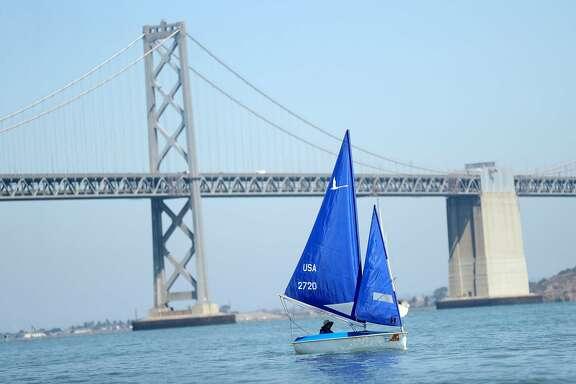 Kathi Pugh sails near the Bay Bridge in San Francisco, Calif. on Friday, September 7, 2018.