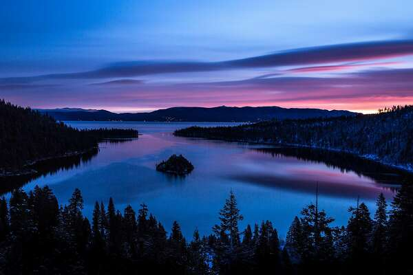 SOUTH LAKE TAHOE, CA - JANUARY 21: A dramatic sunrise colors the sky over Emerald Bay on January 21, 2018, in South Lake Tahoe, California. Though a six-year drought in California and Nevada was called off last year following record rain and up to 25 feet of snow in the Sierra Nevada Mountain Range, this year's snowfall levels compared to last have been dismal. (Photo by George Rose/Getty Images)