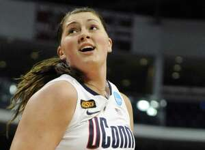 Former UConn center Stefanie Dolson turns to the basket during the first half of an NCAA tournament second-round game against Kansas State on March 19, 2012, in Bridgeport.