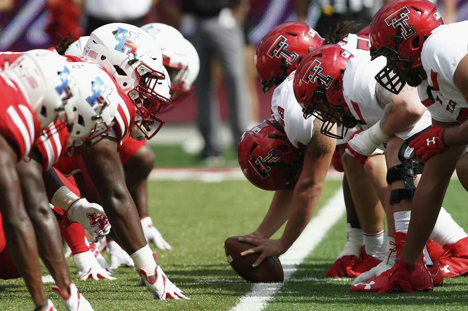 PHOTOS: UH vs. Arizona  A view down the line of scrimmage in the first quarter during the NCAA football game between the Texas Tech Red Raiders and the Houston Cougars at TDECU Stadium in Houston, TX on Saturday, September 23, 2017. >>>See photos from the Cougars' win over Arizona on Saturday, Sept. 8, 2018 ... Photo: Tim Warner, Freelance / For The Chronicle / Houston Chronicle