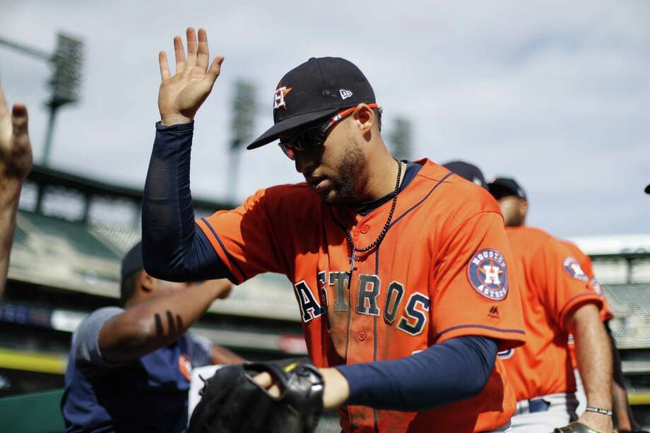 Houston Astros' George Springer celebrates with teammates in the ninth inning of a baseball game against the Detroit Tigers in Detroit, Wednesday. Photo: Paul Sancya, STF / Associated Press / Copyright 2018 The Associated Press. All rights reserved