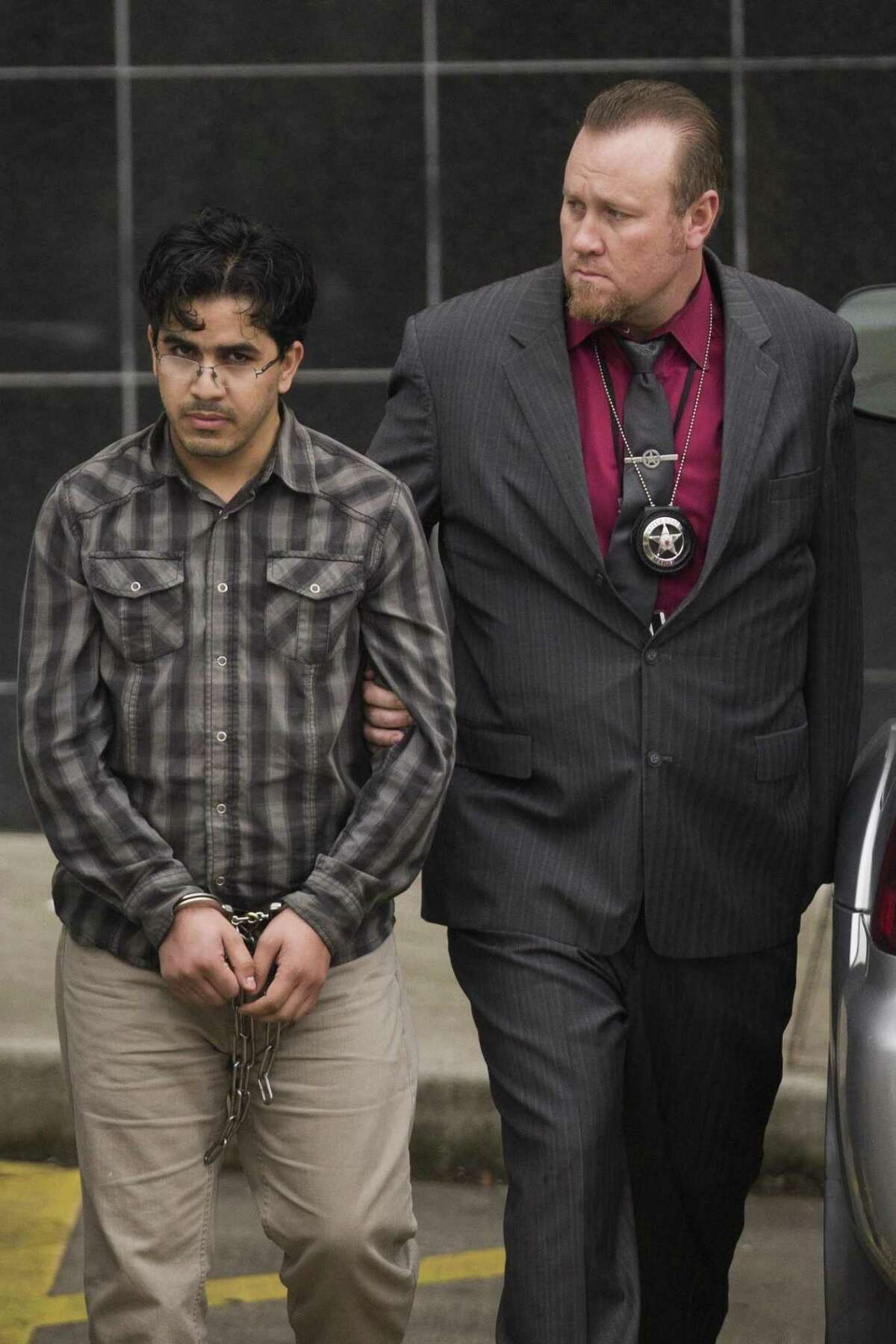 PHOTOS: ISIS supporter Omar Faraj Saeed Al Hardan, left, walks out of the Bob Casey Federal Courthouse accompanied by U.S. Marshals, Friday, Jan. 8, 2016, in Houston. >>See more photos of the convicted ISIS backer who lived here in Houston ...
