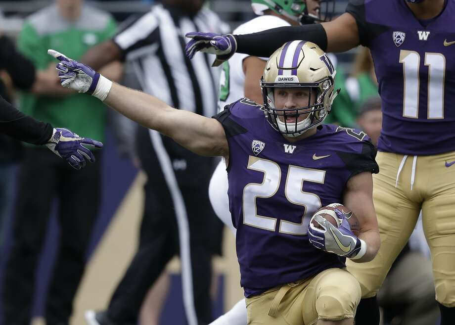 Washington's Ben Burr-Kirven makes his own call against North Dakota in an NCAA college football game Saturday, Sept. 8, 2018, in Seattle. (AP Photo/Elaine Thompson) Photo: Elaine Thompson, Associated Press