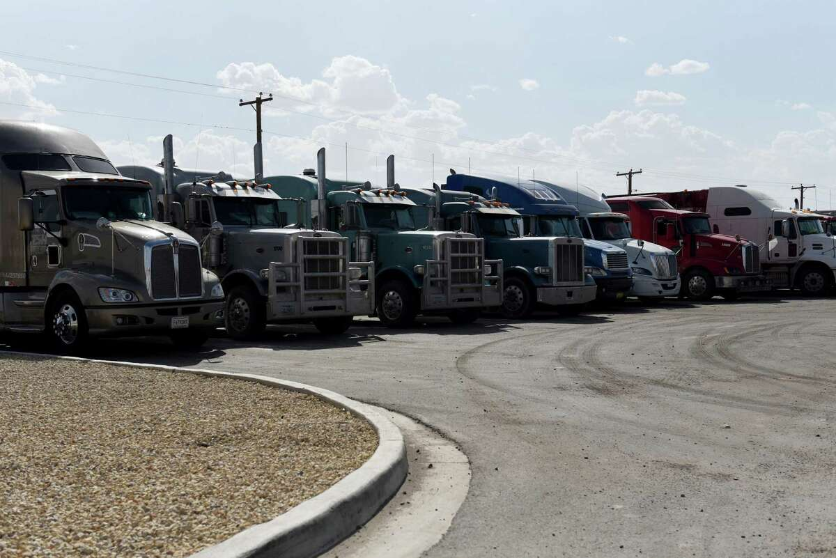 Trucks sit parked outside the Pilot Travel Center in Orla, Texas, U.S., on Wednesday, July 18, 2018.