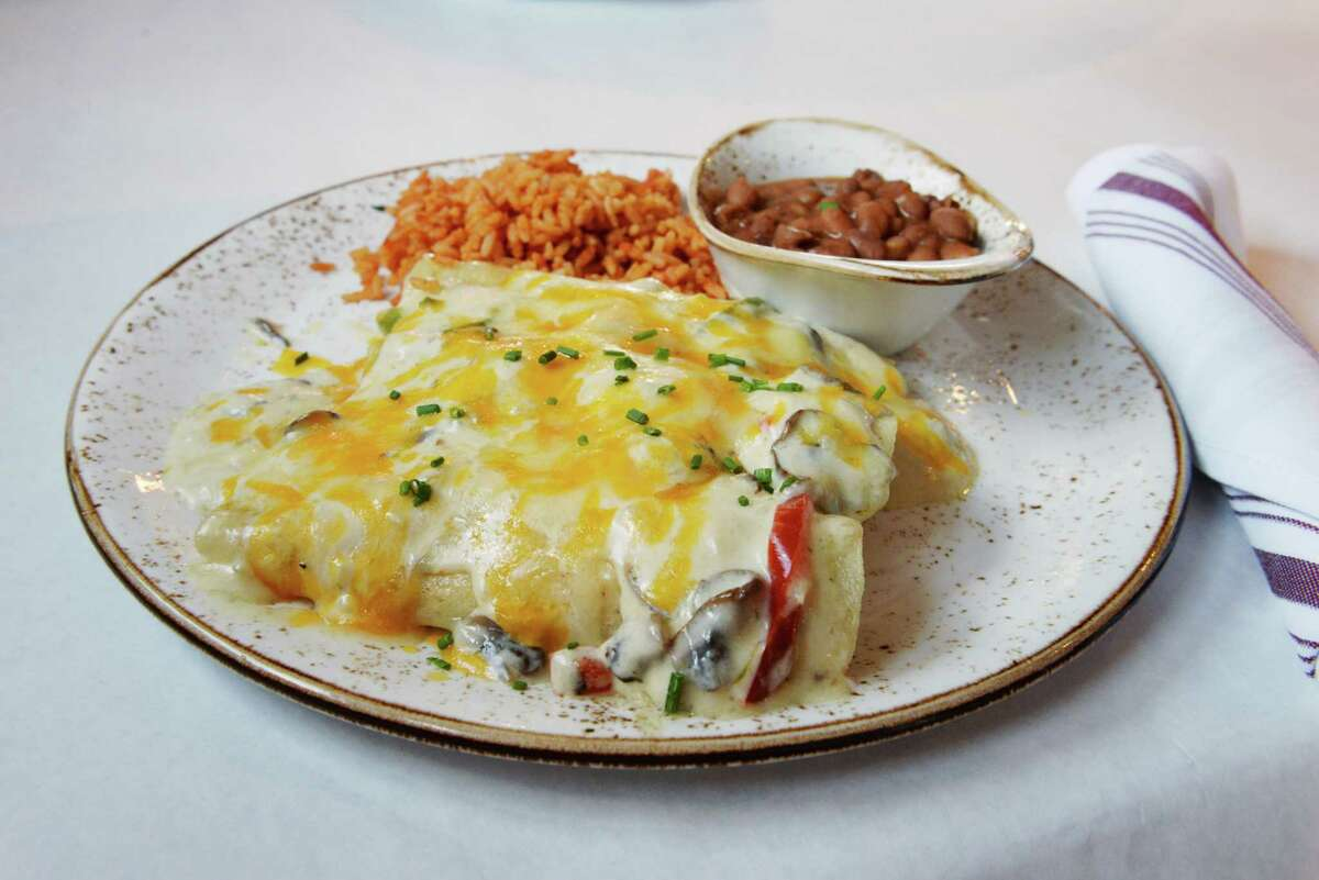Smoked chicken enchiladas will be featured on the menu of chef Ronnie Killen's new Tex-Mex restaurant, Killen's TMX, opening in November 2018 in Pearland.