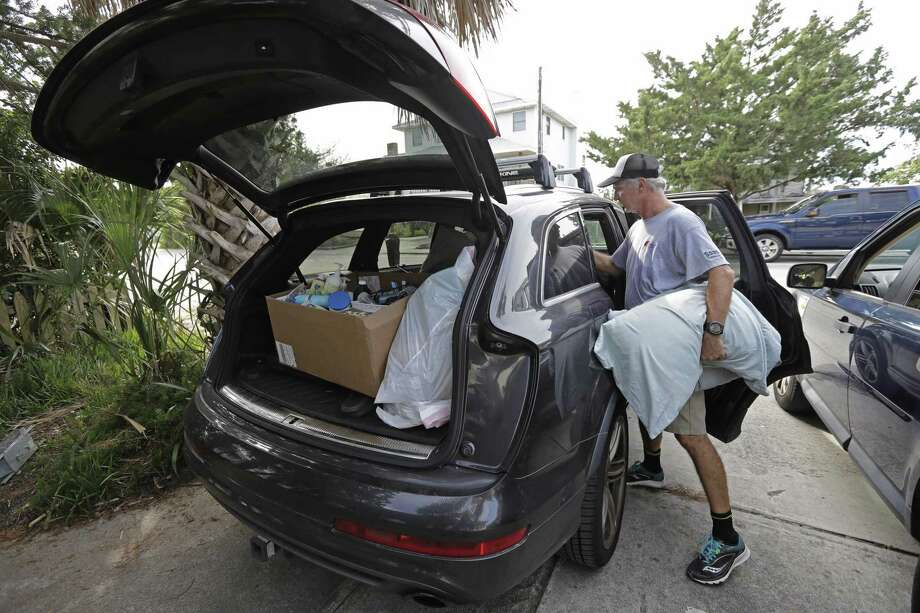 Jason Moore, of Raleigh, N.C., packs to evacuate from Wrightsville Beach, N.C., Wednesday, Sept. 12, 2018 as Hurricane Florence threatens the coast. (AP Photo/Chuck Burton) Photo: Chuck Burton,  STF / Associated Press / Copyright 2018 The Associated Press. All rights reserved