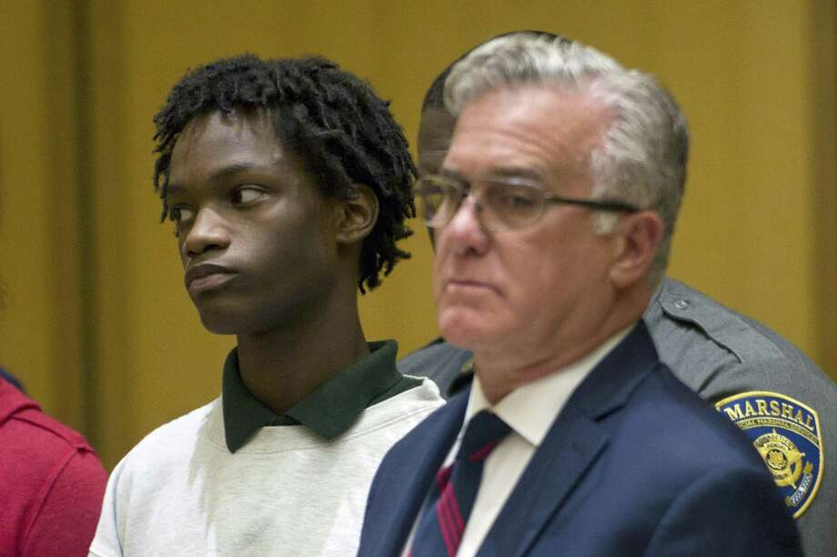 Syrus Dixon, 15, gets arraigned on a murder charge for the shooting death of Antonio Robinson inside the Stamford Superior Court House in Stamford, Conn. on Wednesday, Sept. 12, 2018. Photo: Michael Cummo / Hearst Connecticut Media / Stamford Advocate